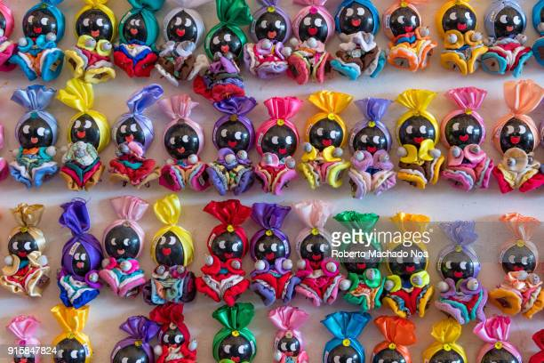 Small souvenirs dolls for sale on a stand The items originated from the African religions brought to Cuba during the slavery period