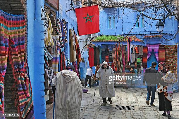 A small square with busy shops in Chefchaouen
