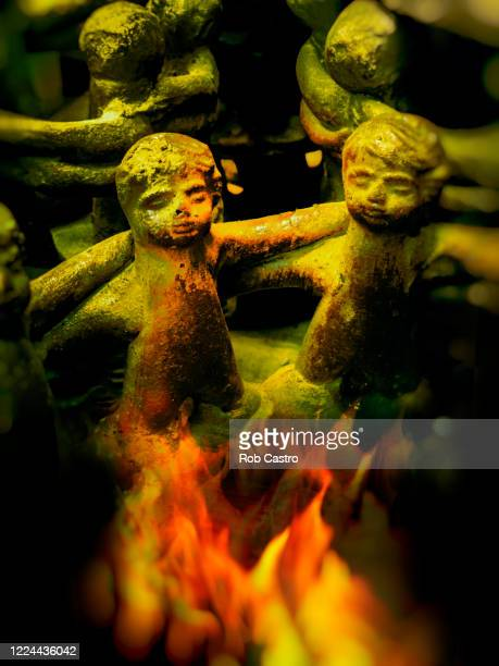 small statues on fire - rob castro stock pictures, royalty-free photos & images