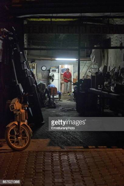 a small steel workshop working late at alacati,cesme. - emreturanphoto stock pictures, royalty-free photos & images