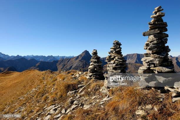 Small stone towers in front of Alpine panorama, Namlos, Lechtal, Reutte, Tyrol, Austria