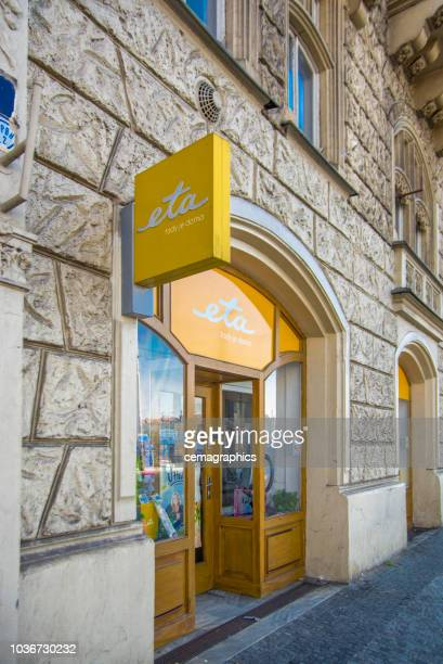 small store in a historic building on prague street - czech model stock pictures, royalty-free photos & images