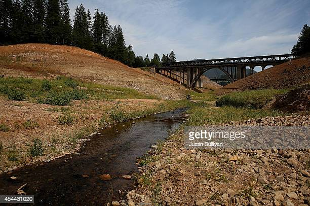 A small stream of water flows through a nearly completly dry inlet of Shasta Lake on August 30 2014 in Lakehead California As the severe drought in...