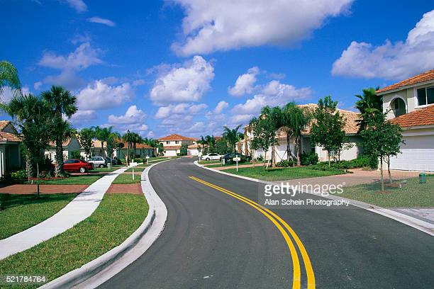 small street through coral springs neighborhood - coral springs stock pictures, royalty-free photos & images
