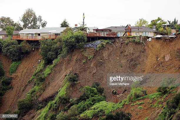 A small swimming pool hangs off the top of a 200foottall crumbling mud cliff that threatens to drop four homes above the Arroyo Seco Wash on February...