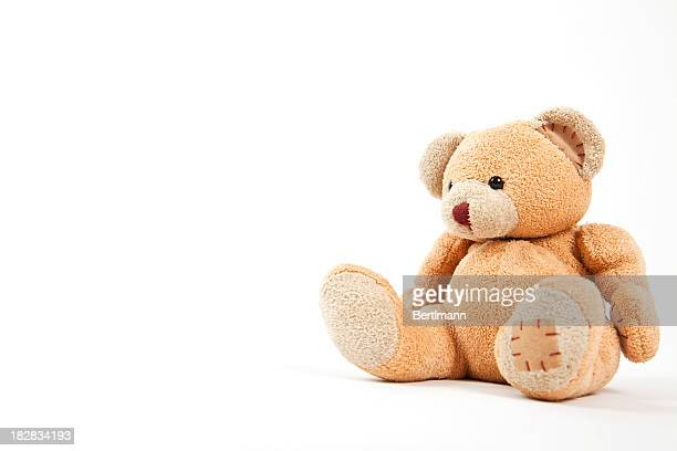 small teddy bear isolated on white  - stuffed toy stock pictures, royalty-free photos & images