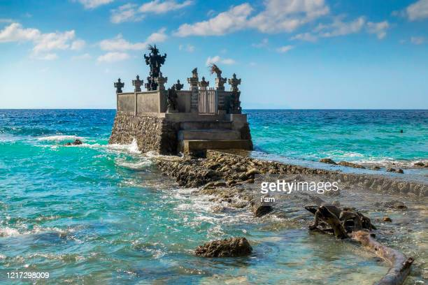 small temple on the shore by the sea on nusa penida with blue sky above bali, indonesia - east stock pictures, royalty-free photos & images