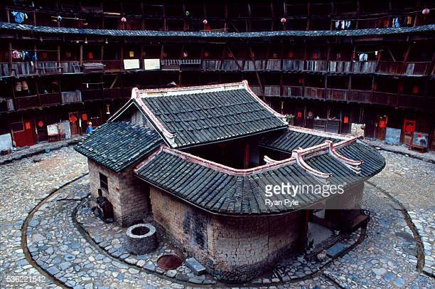 Small temple sits in the inner courtyard of a traditional Hakka Tulou home in the county of Yongding, well known as the Hakka Tulou region, in...