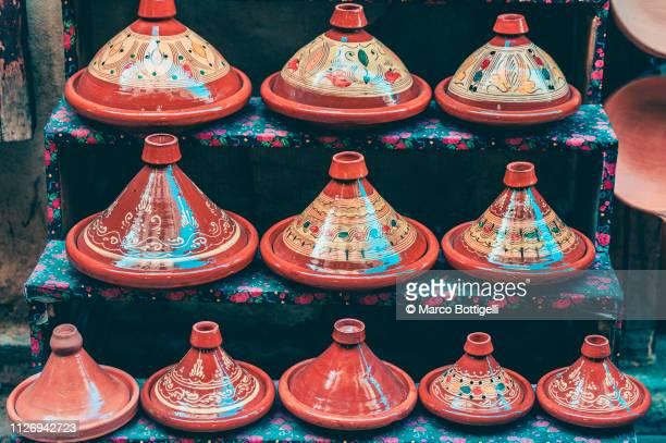 small terracotta tajine (tagine) souvenirs, morocco - tajine fotografías e imágenes de stock