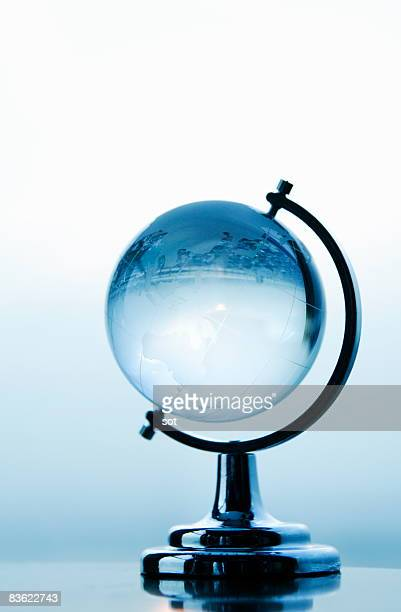 Small terrestrial globe,evening sun background