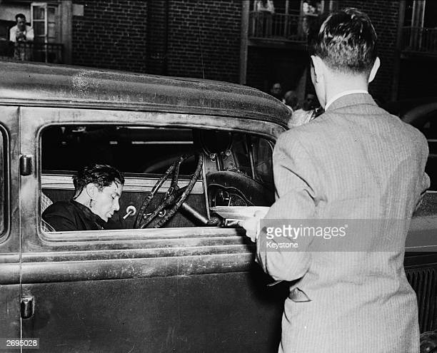 Small time gangster Turi Montalbano lies dead in a car parked outside his girlfriend's apartment at 1025 45th Street Brooklyn New York Montalbano's...