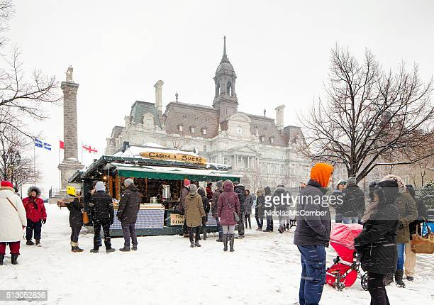 Small tourist crowd brave snowy weather to visit Old Montreal