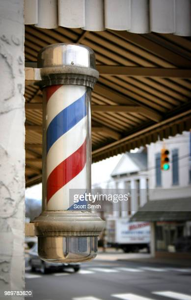 small town barber - barber pole stock photos and pictures