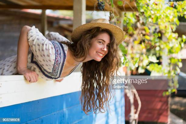 small town girl - bend over woman stock pictures, royalty-free photos & images