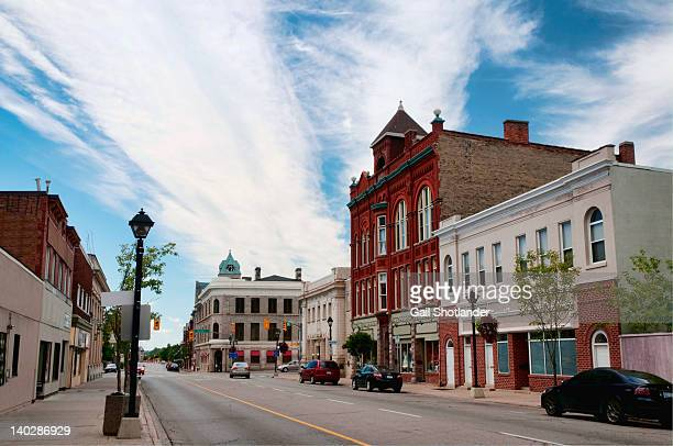 small town main street - town stock pictures, royalty-free photos & images