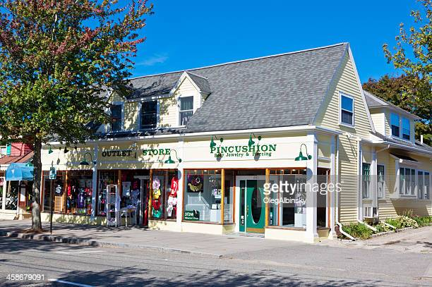 small town street lined with stores, hyannis. morning blue sky. - hyannis port stock pictures, royalty-free photos & images