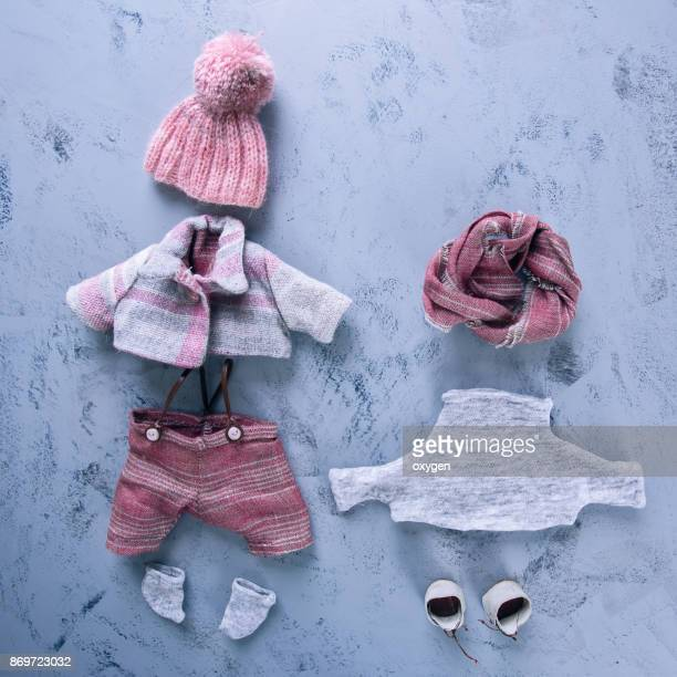 Small toy clothes on a blue background