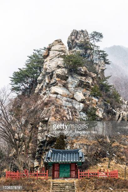 a small traditional shrine in front of the rock - gangwon province stock pictures, royalty-free photos & images