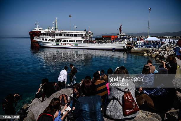 A small Turkish ferry carrying migrants deported from Greece to Turkey arrives on April 4 2016 in the port of Dikili district in Izmir Migrants...