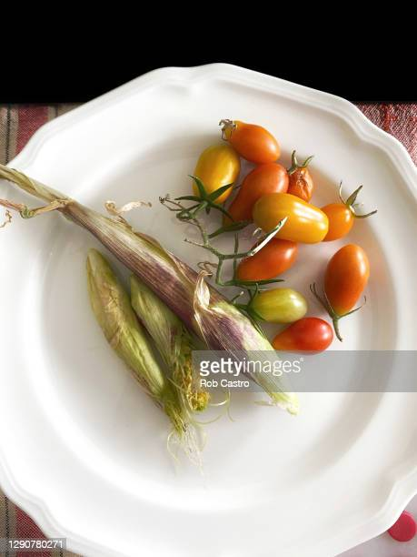 small vegetables on plate - rob castro stock pictures, royalty-free photos & images