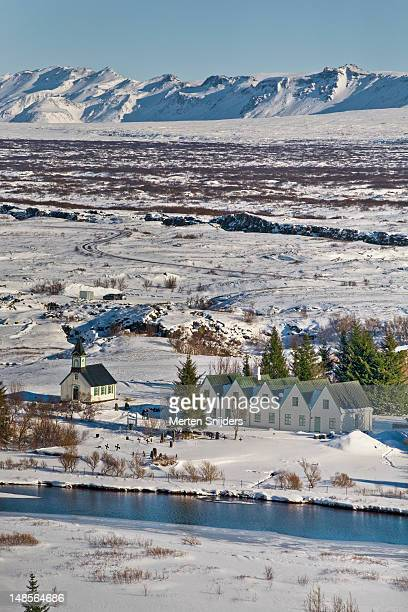 small village and surrounding mountains in winter. - merten snijders stock pictures, royalty-free photos & images