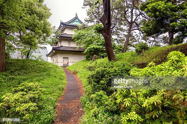 Small walking path with imperial palace building in view, Tokyo, Japan