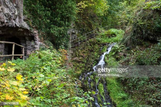 Small waterfall at the Elfengrotte, Vulkaneifel, Bad Bertrich, Rhineland-Palatinate, Germany, Europe.