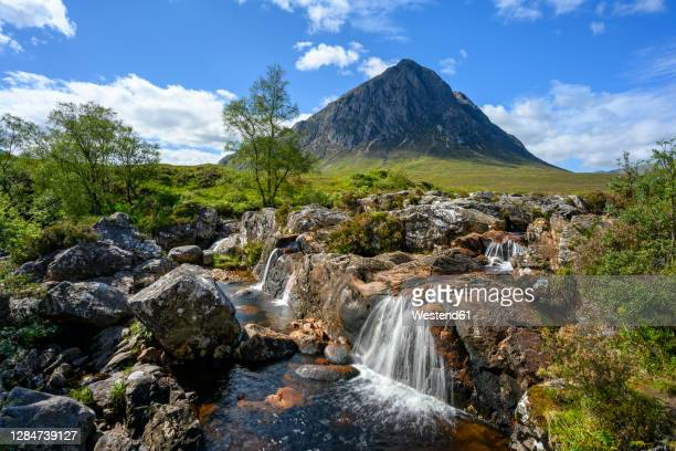small waterfalls in glen etive with stob dearg peak in background - grampian scotland stock pictures, royalty-free photos & images