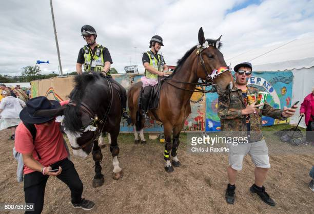 Small wearing a fairy costume sits on top of her horse Sedgemoor who is wearing garlands as she and her colleague interact with the public at...