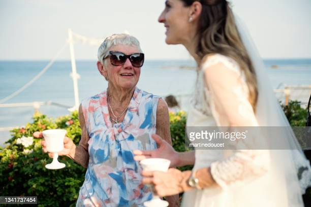 """small wedding celebrations in family beach house. - """"martine doucet"""" or martinedoucet stock pictures, royalty-free photos & images"""
