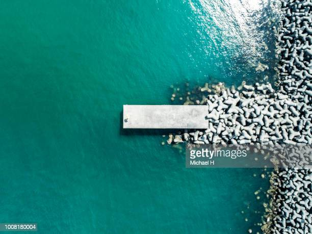 small wharf and ocean - emerald green stock pictures, royalty-free photos & images