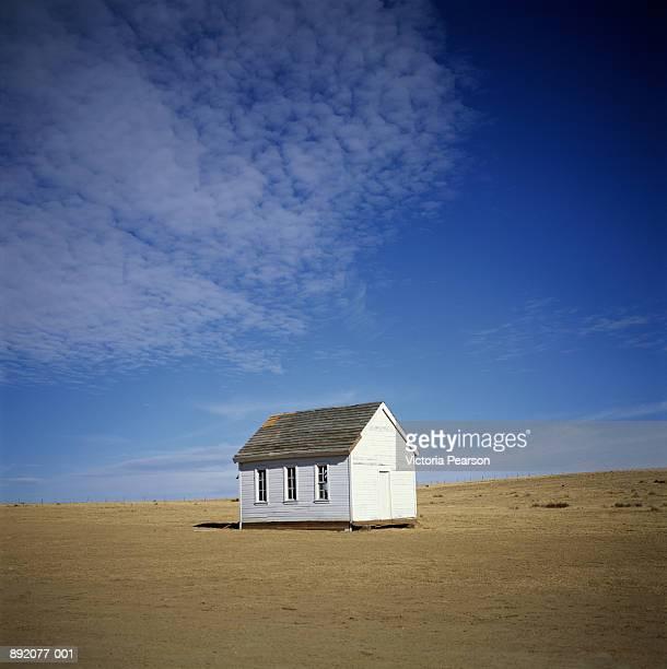 Small white house in desolate area, New Mexico, USA