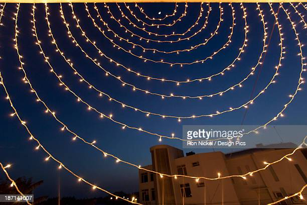 Small White Lights Strung In A Circular Pattern Against A Night Sky