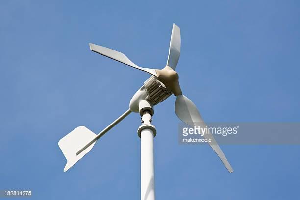 Small Wind Turbine Against Blue Sky