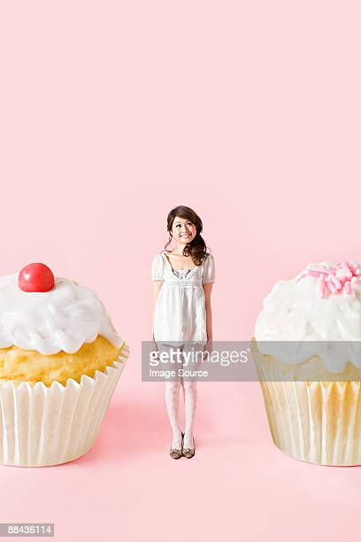 Small woman and big cakes