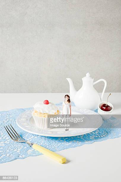 Small woman on plate