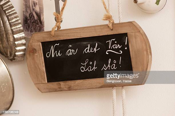 Small wooden board with chalk handwriting