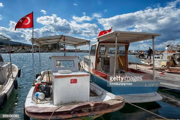 small wooden fishing boats at narlidere marina ,izmir. - emreturanphoto stock pictures, royalty-free photos & images