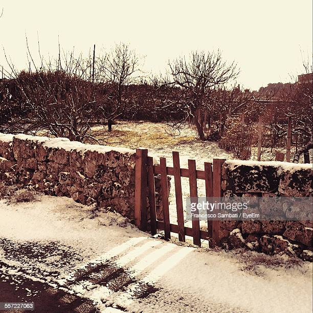 Small Wooden Gate At Stone Walls