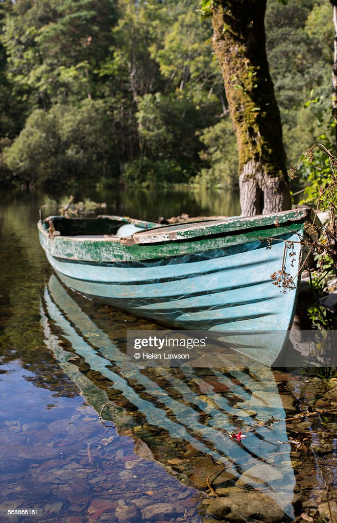 Small wooden rowing boat on river at Cong : Stock Photo