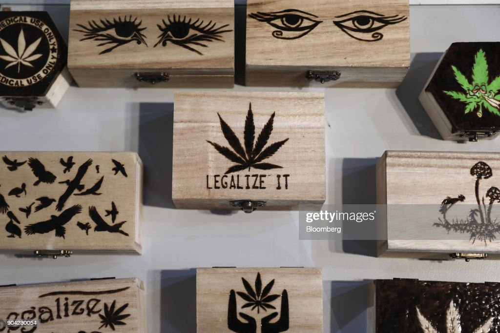 Small wooden 'stash' boxes decorated with marijuana leaves, magic mushrooms and related pot paraphenalia sit on display at the 1st International Cannabis Expo at the Faliro Sports Pavilion in Athens, Greece, on Friday, Jan. 12, 2018. The purpose of the event is to inform the public about all the products and innovations that exist in the world of cannabis and the latest achievements in the medical, pharmaceutical and industrial use of cannabis. Photographer: Yorgos Karahalis/Bloomberg via Getty Images