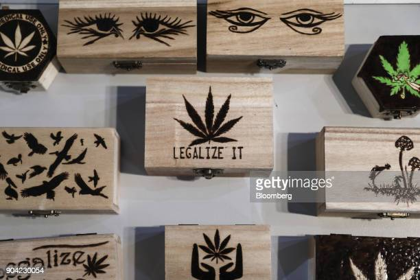 Small wooden 'stash' boxes decorated with marijuana leaves magic mushrooms and related pot paraphenalia sit on display at the 1st International...