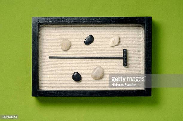 A small wooden zen garden