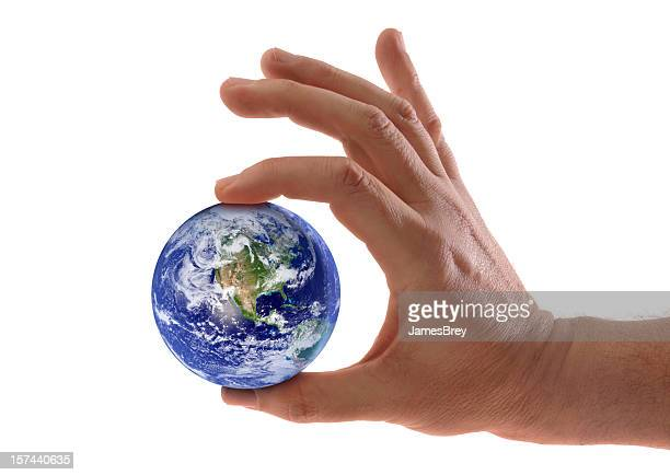 small world, planet earth held in hand, fingers squeezing globe - earth day stock pictures, royalty-free photos & images