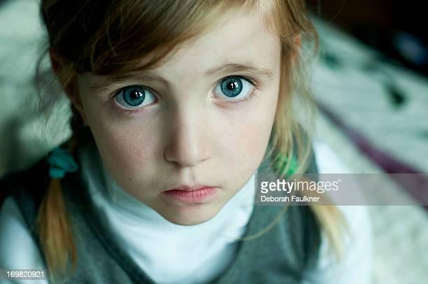 Small worried girl in uniform