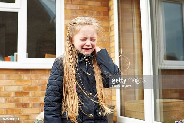 small young girl crying