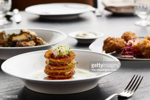 Smaller plates include from left to right: Roasted Brussels Sprouts with Honey & Soy Glaze and Benne Seeds, Fried Green Tomatoes Stack with Pimento...