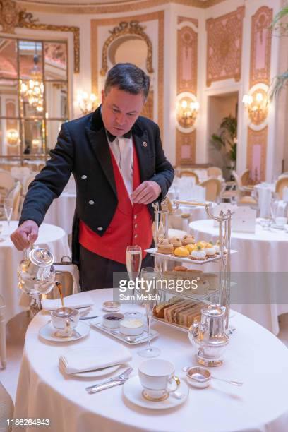 A smarlty dressed male waiter pours tea in Palm Court at The Ritz on the 4th October 2019 in London in the United Kingdom Palm Court is a...