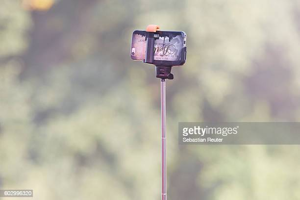 A smarphone on a selfie stick is seen during the Lollapalooza Berlin music festival at Treptower Park on September 11 2016 in Berlin Germany