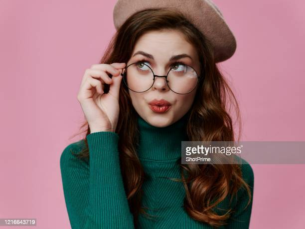 smart and decent girl thinking about something - eyewear stock pictures, royalty-free photos & images